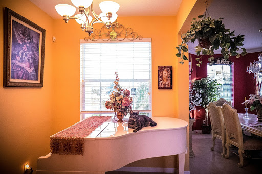 Interior shot of a dining room with a piano