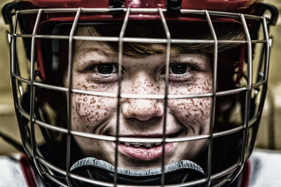 Young boy wearing a foam-lined sports helmet